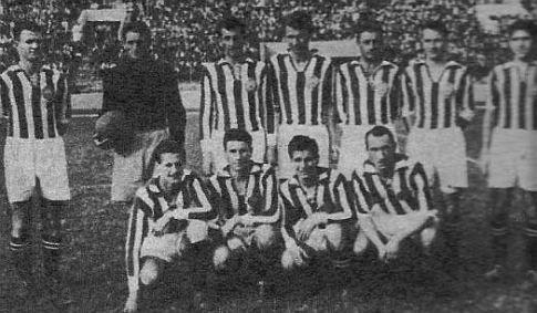 Šampionska ekipa Partizana. Stoje (sleva): Bobek, Šoštarić, Čolić, Drenovac, Jovanović, Herceg i Jakovetić. Čuče (sleva): Lazarević, Valok, Šijaković i Atanacković.
